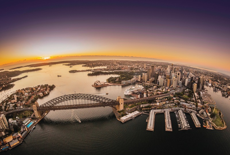 Sydney Harbour at Twilight, the sun goes down on the horizon.